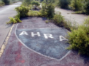 The AHRA logo painted on the pavement between the twin tracks just past the starting line.