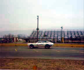 The bleachers in the 1970s have been moved from their original location out into parking lot onto their backs.