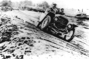 Fisher pilots his Stoddard-Dayton during the first trip around the newly built track in 1909.  Photo courtesy Indianapolis Motor Speedway.