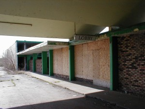The boarded up lobby entrance.