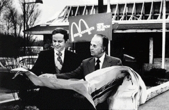 At left, Ray and his right-hand man, Fred Turner, look over the plans for a new McDonald's of the same design as the Lebanon store.