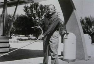 Ray cleaning the sidewalk of his first McDonald's franchised store in Des Plaines, Illinois.