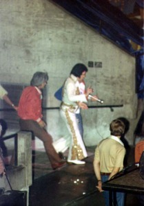 Elvis Presley walks onto the stage for the last time.