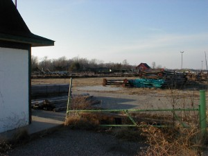 The parking lot entrance ticket shed, with disassembled ride in the foreground, and the main ticket windows in the distance.