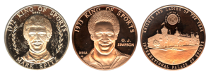 Coins depicting Mark Spitz and OJ Simpson.