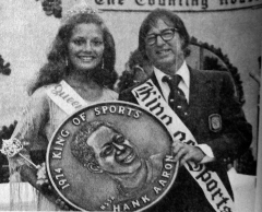 "The Bobby Riggs attempts to stand in for Hank Aaron at the 1974 event. He's next to that year's Queen of the Lakes Terry Kaiser, a job the noted ""Battle of the Sexes"" tennis star no doubt enjoyed. [Click on any picture for a larger view]"
