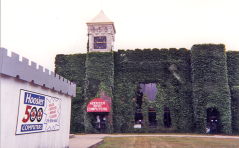 "A slightly older picture from late 1990s depicts the old Counting House Bank portion in use as the now defunct ""Hoosier 500 Computers.""  It occupied the new bank space on the north side."