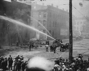 The Prest-O-Lite factory at 211 East South Street in Indianapolis burns in 1907. The explosion also blew up a sauerkraut plant nearby, spraying wet kraut all over the block. The city passed an ordinance forbidding the filling of the gas canisters within city limits, so Fisher built a giant new plant in what would become Speedway, Indiana. Photo from the W. H. Bass Photo Company Collection (9490), courtesy Indiana Historical Society.