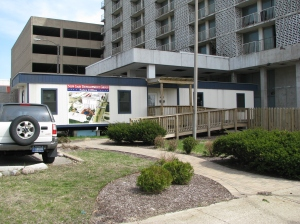 As of April 2009, a portable trailer now sits tucked under the awning of the hotel, promoting a fresh plan for redevelopment.