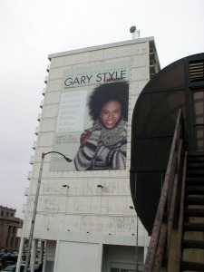"The ""Gary Style"" banner on the side of the hotel facing the Genesis Convention Center. A second banner with the 2002 event dates covers the original dates."