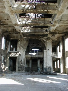 The massive main hall, looking from the front doorway. The glass skylights are gone, as are all of the windows and doors.